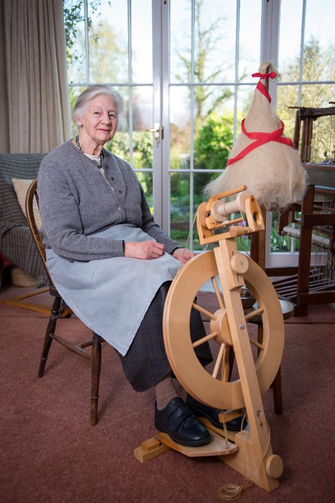 Ann at her spinning wheel