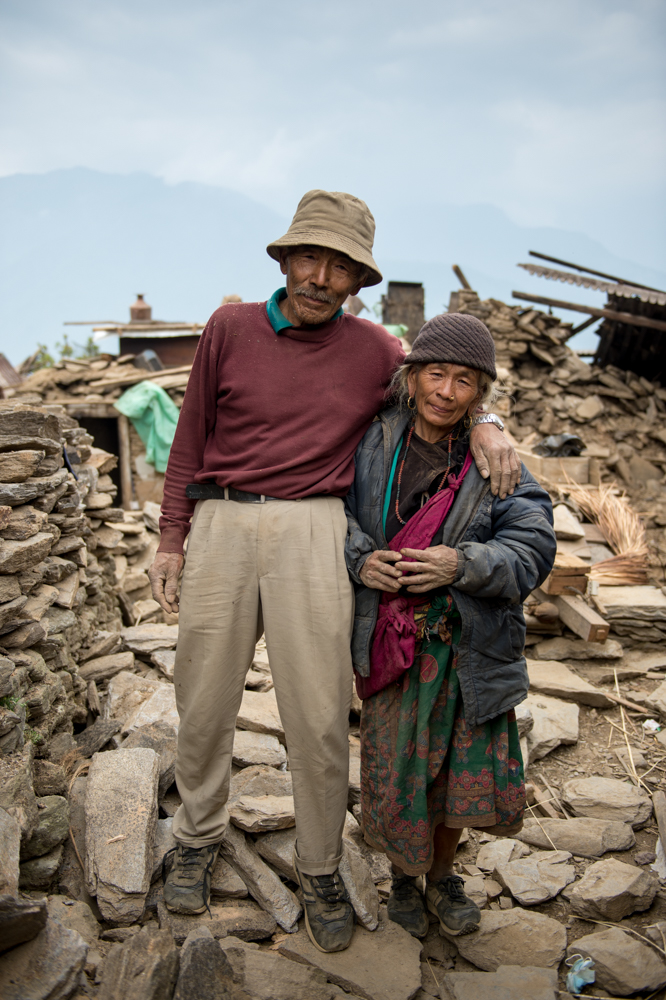 Ex Rifleman Baldhan Ghale from 1/2 Gurkha Rifles, and his wife in front of their house