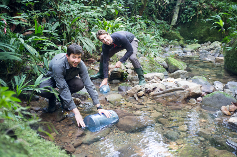 Tom and Huw gathering drinking water