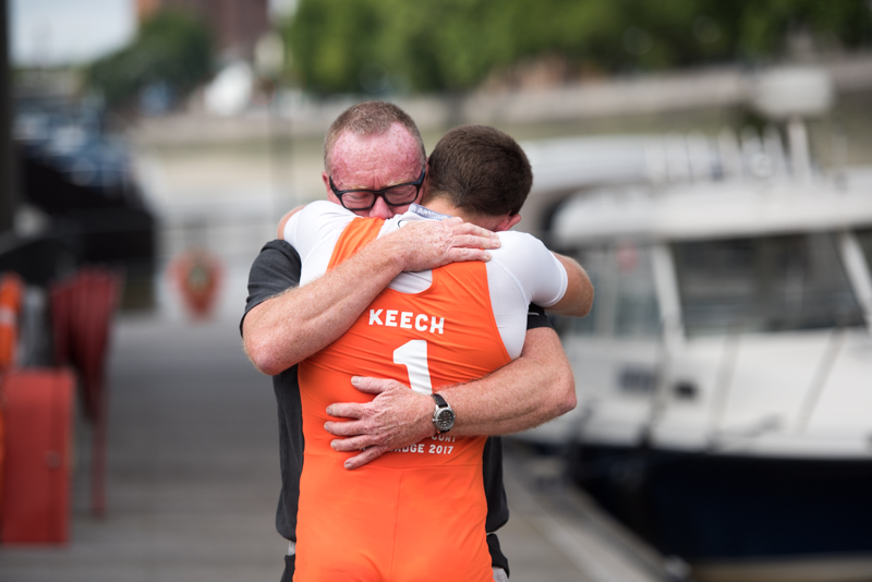 Boat race winner being congratulated by his dad